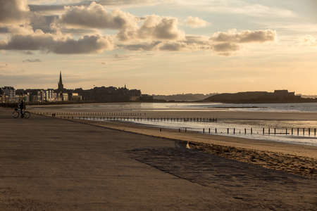 Saint-Malo, France - September 16, 2018: The evening light on beach and olt town of Saint Malo, France, Ille et Vilaine, Brittany, France,
