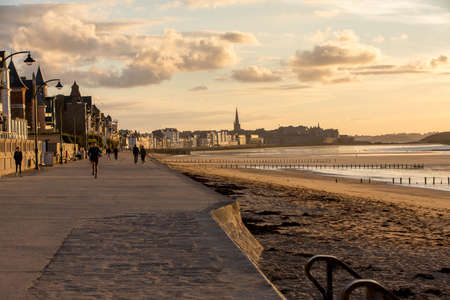 St Malo, France - September 14, 2018: People walking along promenade at seafront in Saint Malo, Brittany, France Sajtókép