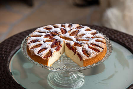 Delicious plum cake sprinkled with powdered sugar