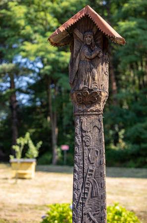 Wygiezlow, Poland - August 14, 2020: Wooden wayside shrine with Wola Filipowska moved to the open-air museum in Wygiezlow. Poland