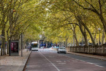 Bordeaux, France - September 9, 2018: Public garden along Place des Quinconces, Bordeaux France, with a canopy of green trees. Editorial