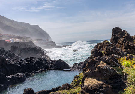 Porto Moniz, Portugal - April 18, 2018: Coastline in Porto Moniz on Madeira Island. Portugal 版權商用圖片