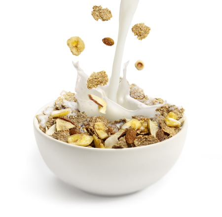cereal: Pouring milk into a bowl with breakfast cereal