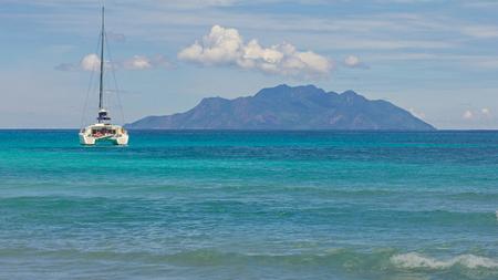 Island with sailboat Stockfoto