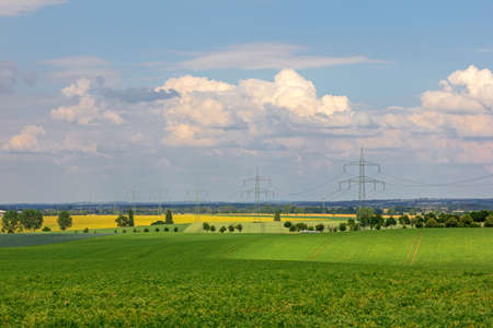 View over the country with fields and high-voltage lines