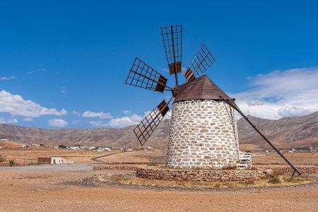 a windmill in a barren landscape