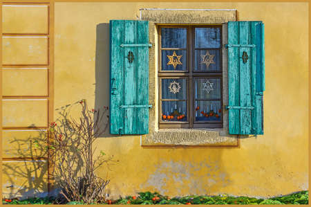 Blue shutters on a yellow house
