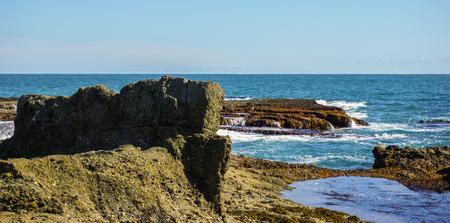 rectangle: a large and rectangle rock on laguna beach