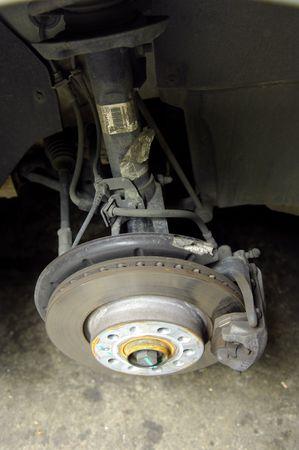 Mechanic tightening or loosening the lugs of an aluminum rim photo