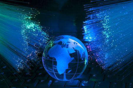 telecomm: globe with network on technology fiber optics background