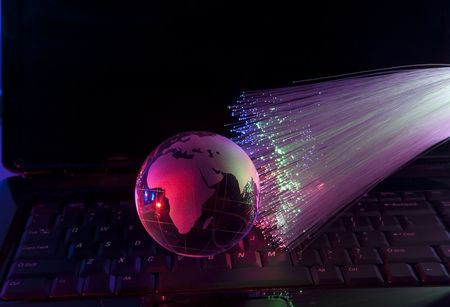 globe with network on technology fiber optics background  Stock Photo - 7796638