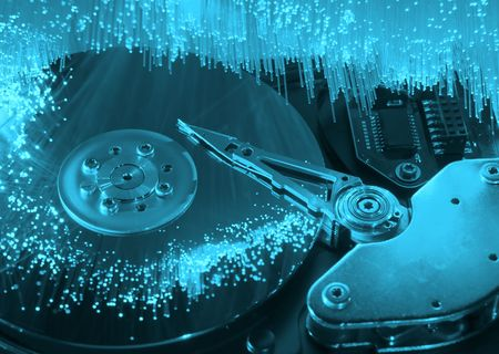 Computer hard drives with technology fiber optics background Stock Photo - 9684402