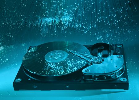 Computer hard drives with technology fiber optics background Stock Photo - 9684403