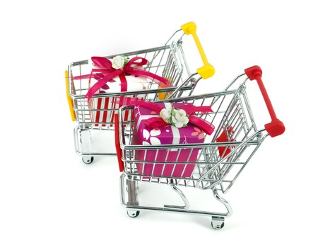 gift box with shopping carts over white background Stock Photo - 7524479