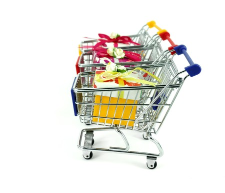 gift box with shopping carts over white background Stock Photo - 7524467