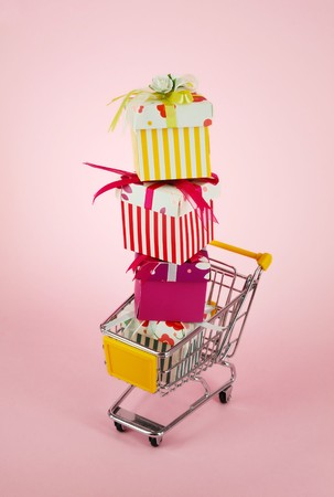 gift box with shopping carts over white background Stock Photo - 8018156