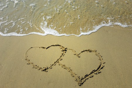 two hearts drawn in beach in sunset Stock Photo - 7023183