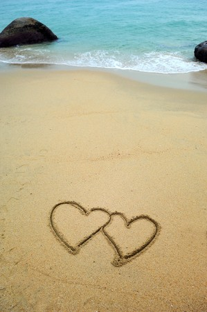 two hearts drawn in beach in sunset Stock Photo - 8018063