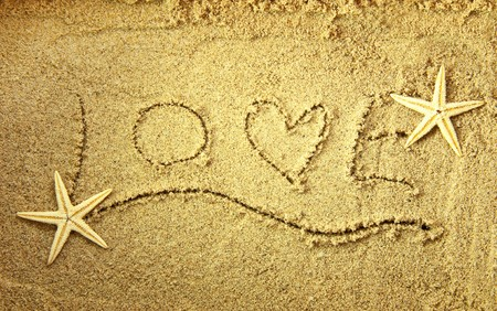 Love in the sand with starfish photo