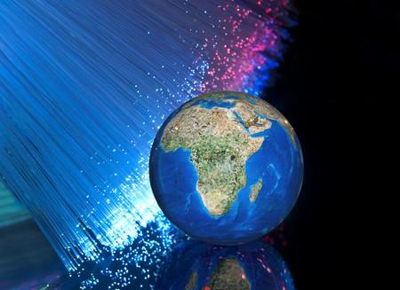 world map technology style against fiber optic background Stock Photo - 8017932