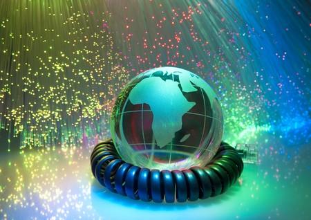 globe with network on technology fiber optics background  photo