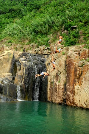 four person only: Men jumping into the water