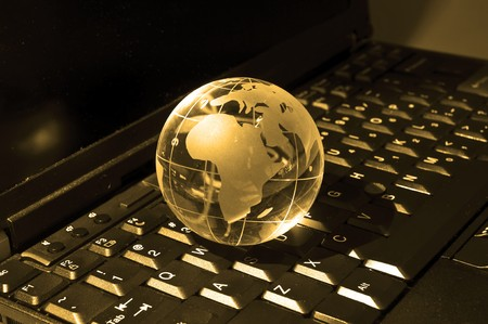 international internet: glass globe on a laptop keyboard
