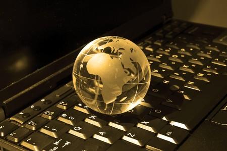glass globe on a laptop keyboard photo