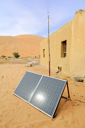 solar symbol: solar panel with desert house
