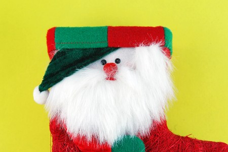 red Christmas stocking isolated on a yellow background photo