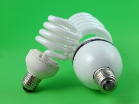 electric economic lamp on a green background Stock Photo - 8271352