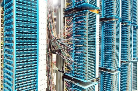 telecommunication equipment: network cables and servers in a technology data center  Stock Photo