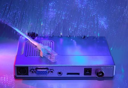 media plug and hub with fiber optical background photo
