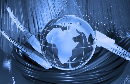 photon: world map technology style against fiber optic background