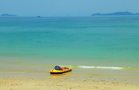 rubber boat on beautiful beach Stock Photo - 13353890