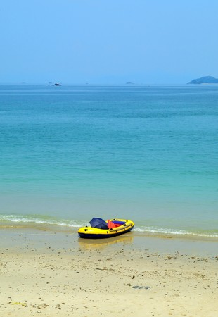 rubber boat on beautiful beach Stock Photo - 13353887