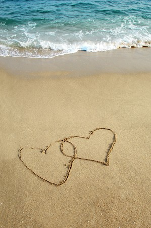 two hearts drawn in beach Stock Photo - 8225311