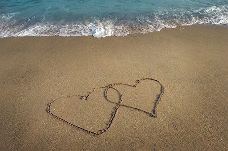 two hearts drawn in beach Stock Photo - 8225330