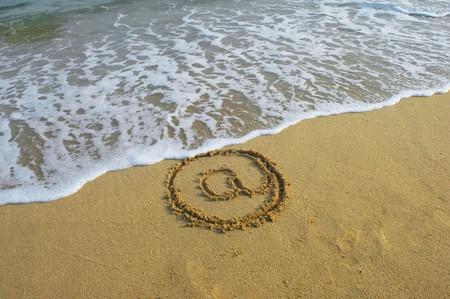 Email symbol draw on beach  photo