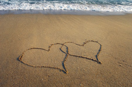 two hearts drawn in beach Stock Photo - 8225332