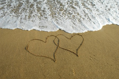 two hearts drawn in beach Stock Photo - 8225327