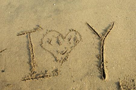 sand writing: Sand writing - I Love You Stock Photo
