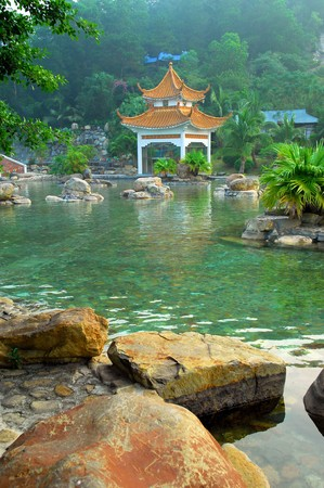 screened: hot spring on a river with chinese gloriette Stock Photo