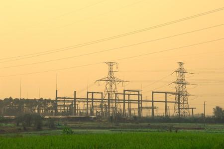 electricity pylon: Electric pillar over blue sky in sunset