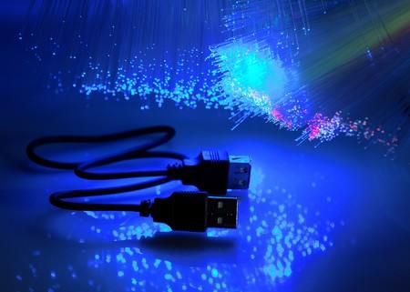 USB plugs closeup with fiber optical background more in my portfolio Stock Photo - 8141872