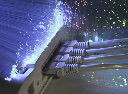 network cable and hub closeup with fiber optical background  photo