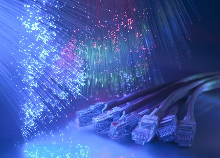 telecommunication equipment: network cable closeup with fiber optical background