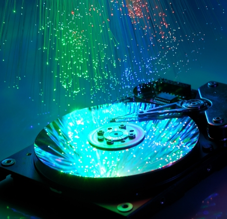 data recovery: Computer hard drives with technology fiber optics background