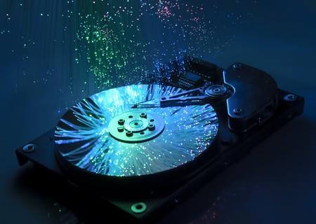 Computer hard drives with technology fiber optics background  photo
