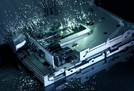 computer harddisk and heads on technology fiber optics background  photo